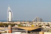 Burh Al Arab und Jumeirah Beach Hotel in Dubai with metro station in front