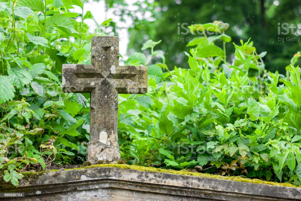 Burial vault cross at the cemetery stock photo
