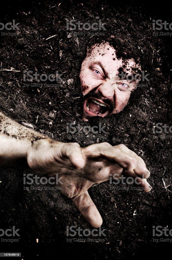 Buried alive stock photo