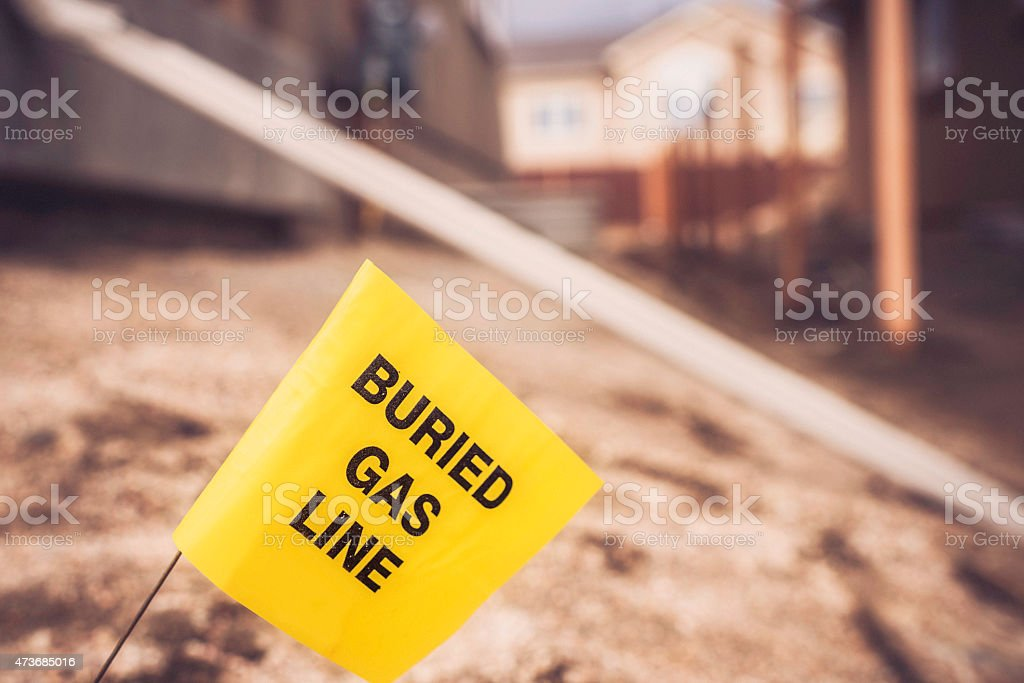 Buried gas line. Call before you dig. Construction and building stock photo
