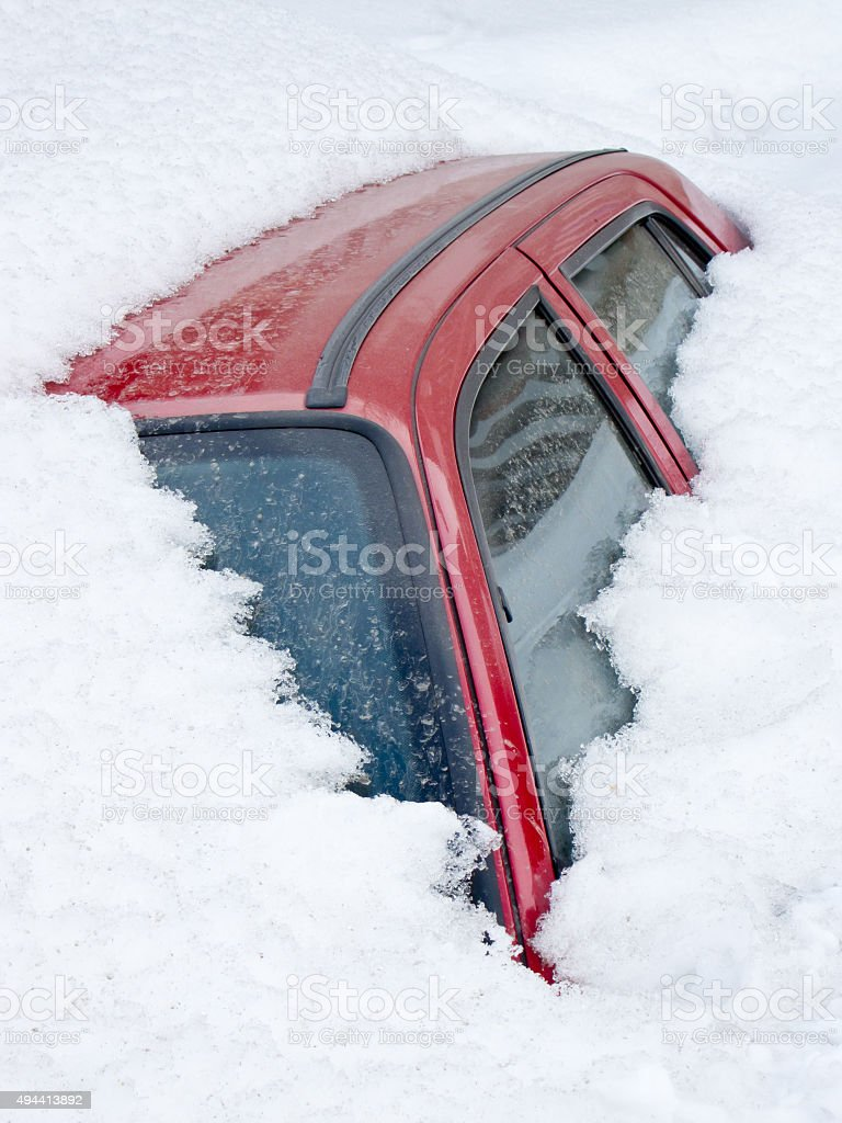 Buried in a snowdrift stock photo