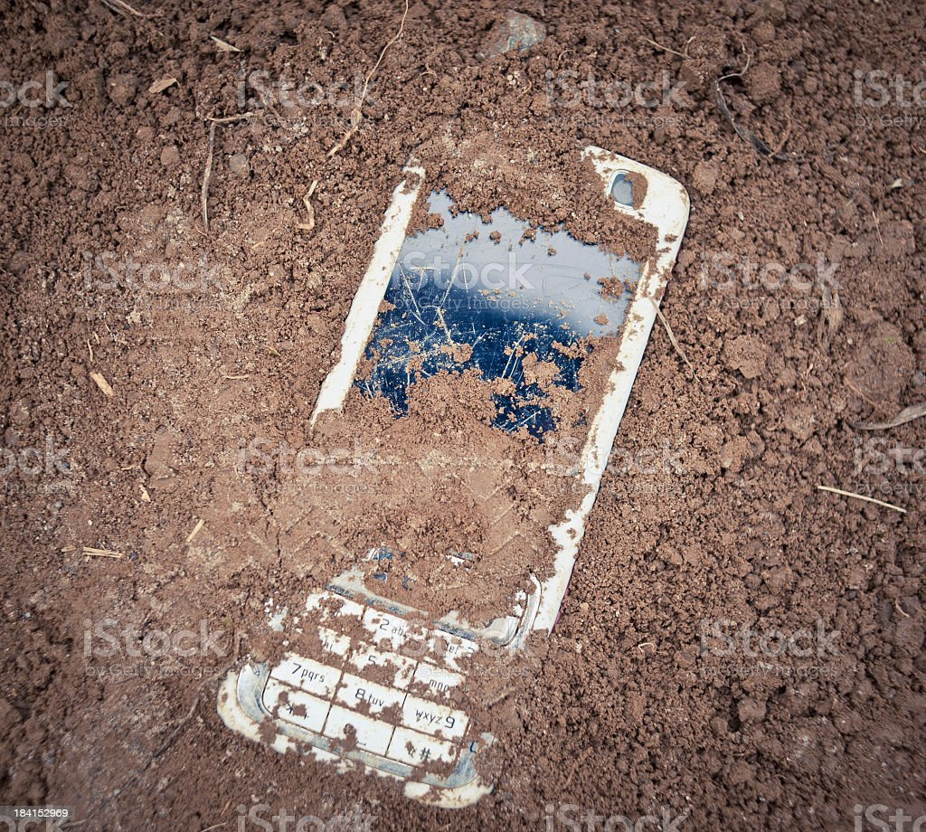 Buried Old Cell Phone stock photo