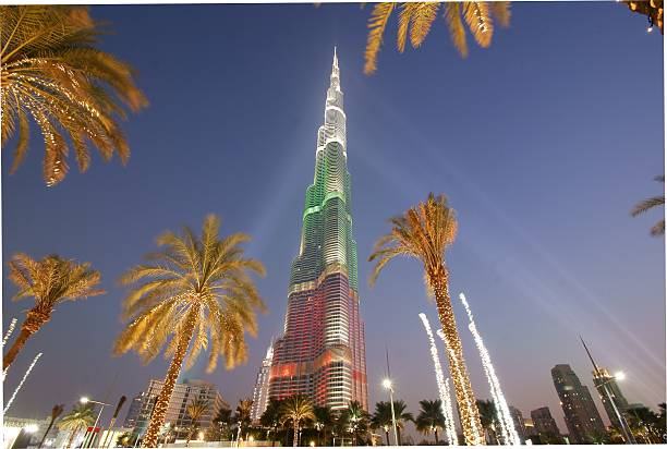 Burj Khalifa (Dubai), December 2013. Dubai, UAE – December 3, 2013: The world's tallest skyscraper at twilight, with the colours of the United Arab Emirates for the National Day.  burj khalifa stock pictures, royalty-free photos & images