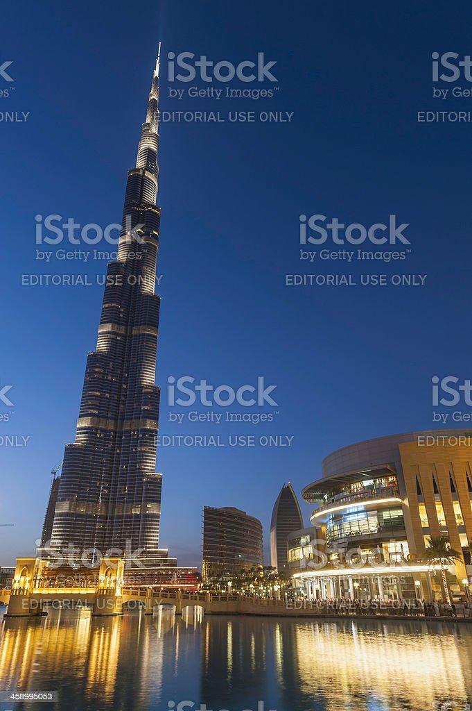 Burj Khalifa Dubai Mall glowing in blue dusk UAE royalty-free stock photo