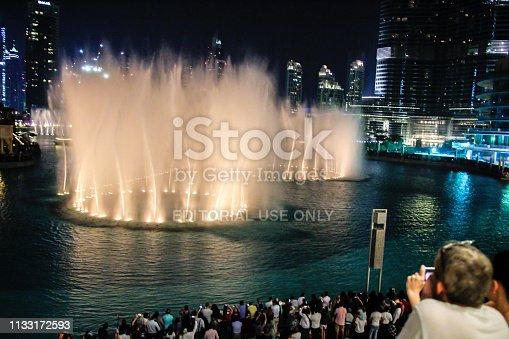 Burj Khalifa, Dubai, UAE - November 1st, 2017: Burj Khalifa dancing fountain with crowd