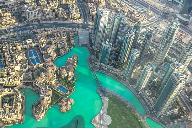 Burj Khalifa Lake aerial Aerial view of Dubai Fountain area and Burj Khalifa Lake and skyscrapers in Dubai downtown, United Arab Emirates, from top. burj khalifa stock pictures, royalty-free photos & images