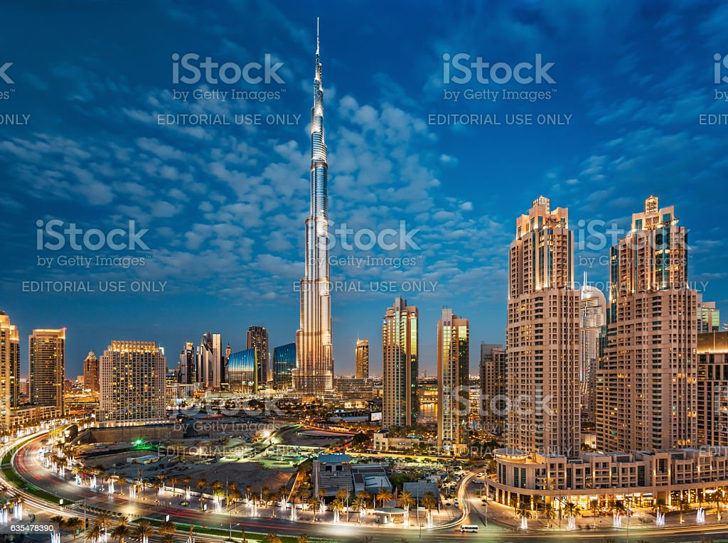 Burj Khalifa With Dubai Downtown Towers at Sunset stock photo