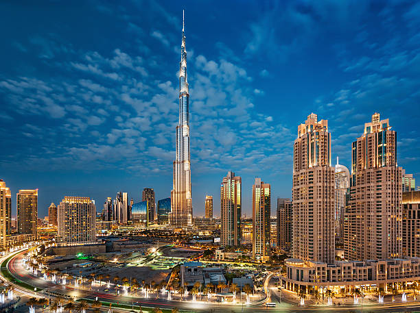 Burj Khalifa With Dubai Downtown Towers at Sunset stock photo
