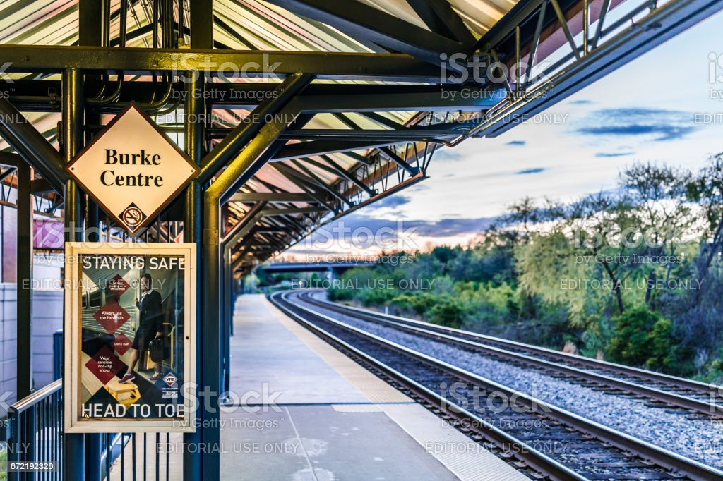 Burke Centre train station platform with sign and tracks stock photo