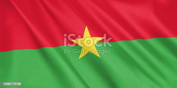 1056280906 istock photo Burkina Faso flag waving with the wind, wide format, 3D illustration. 3D rendering. 1056279190