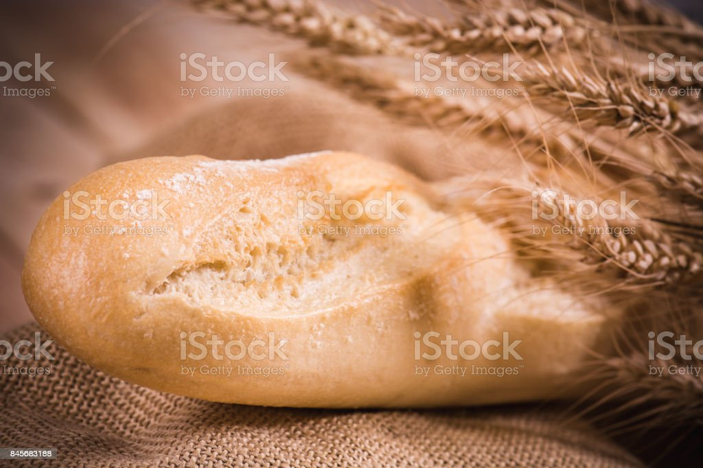 burlap bread wheat wood stock photo