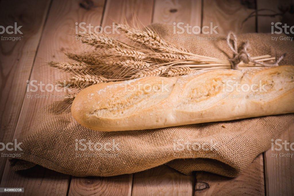 burlap bread wheat wood stock photo