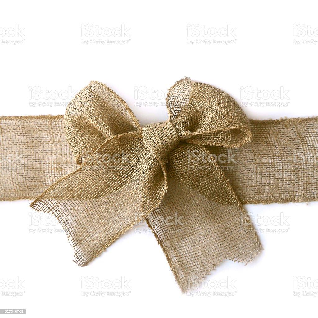 Burlap Christmas Bow Wrapped Around White Background stock photo