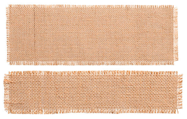 burlap fabric patch piece, rustic hessian sack cloth, torn pieces - pezze di stoffa foto e immagini stock