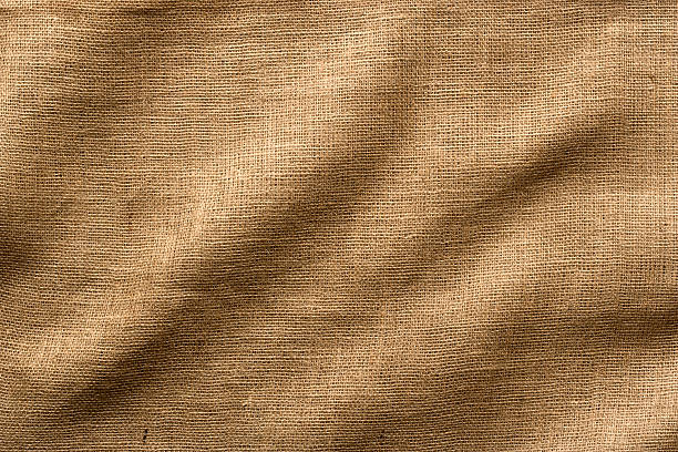 Burlap Fabric with Wrinkles, Wide Shot. Full Frame. Wrinkled Burlap fabric - use as a Horizontal or Vertical image, lots of texture and detail. Full Frame. burlap stock pictures, royalty-free photos & images