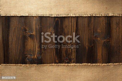 istock Burlap hessian sacking on wood 843202578