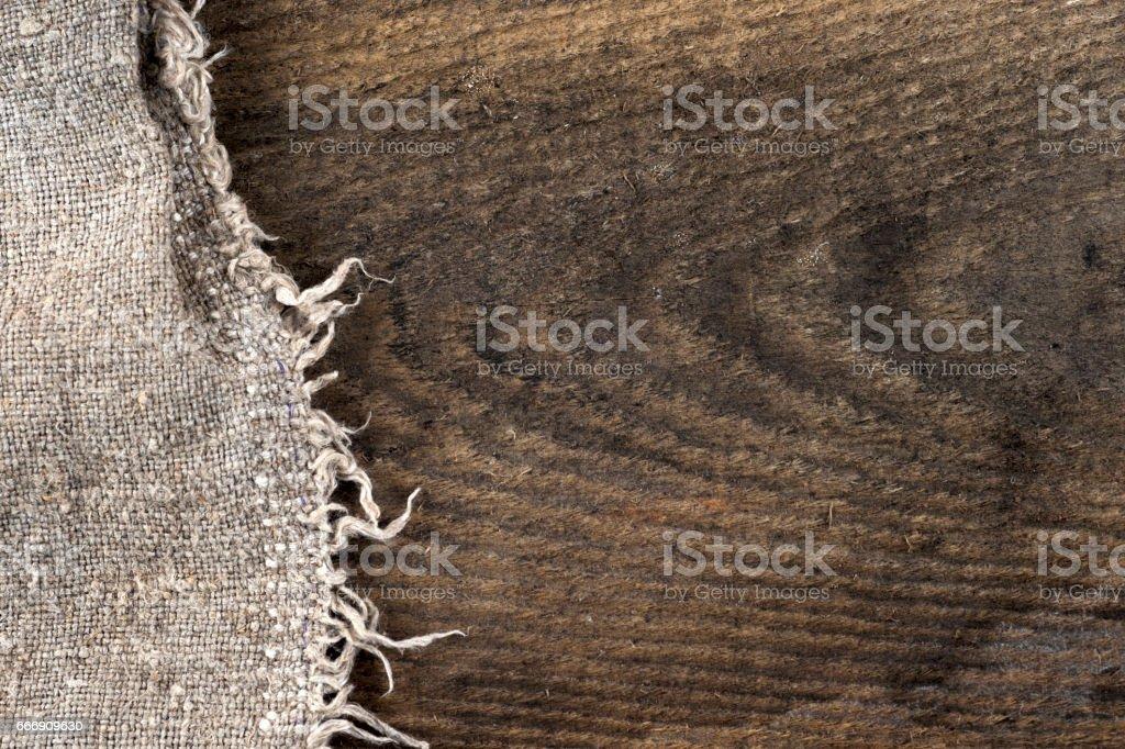 burlap hessian sacking on wooden background stock photo