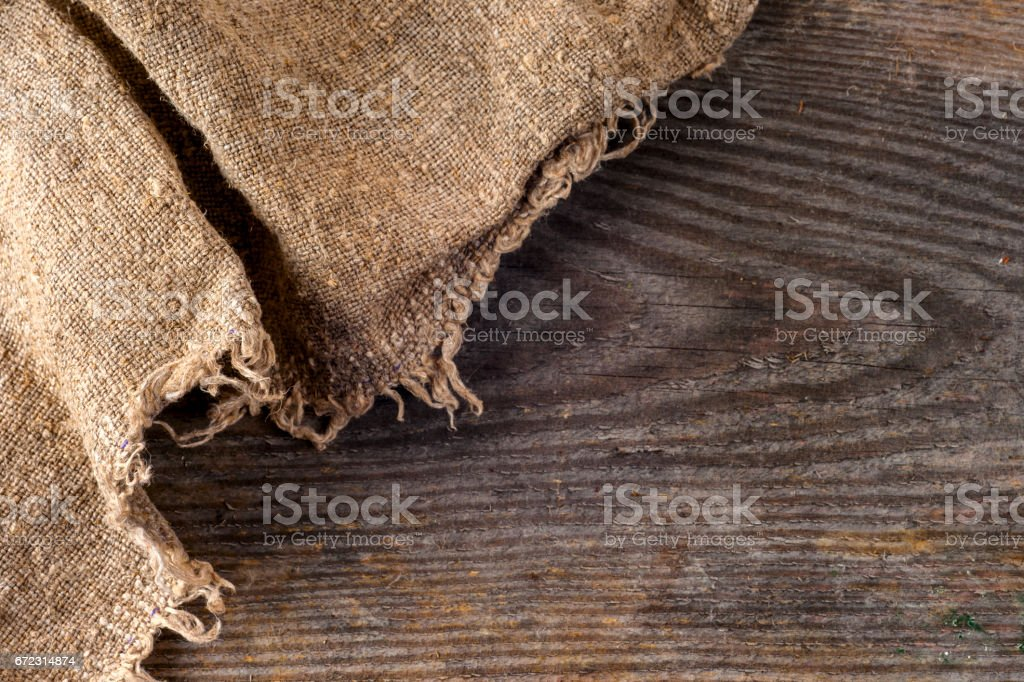 burlap hessian sacking on wooden background stock photo
