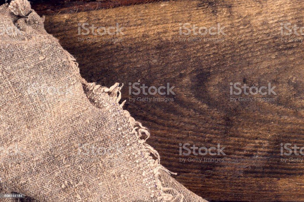 sac de jute toile de jute sur fond en bois - Photo