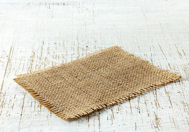 burlap napkin burlap napkin on old wooden table burlap stock pictures, royalty-free photos & images