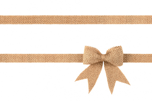 Burlap ribbon bow for gift decoration isolated on white background