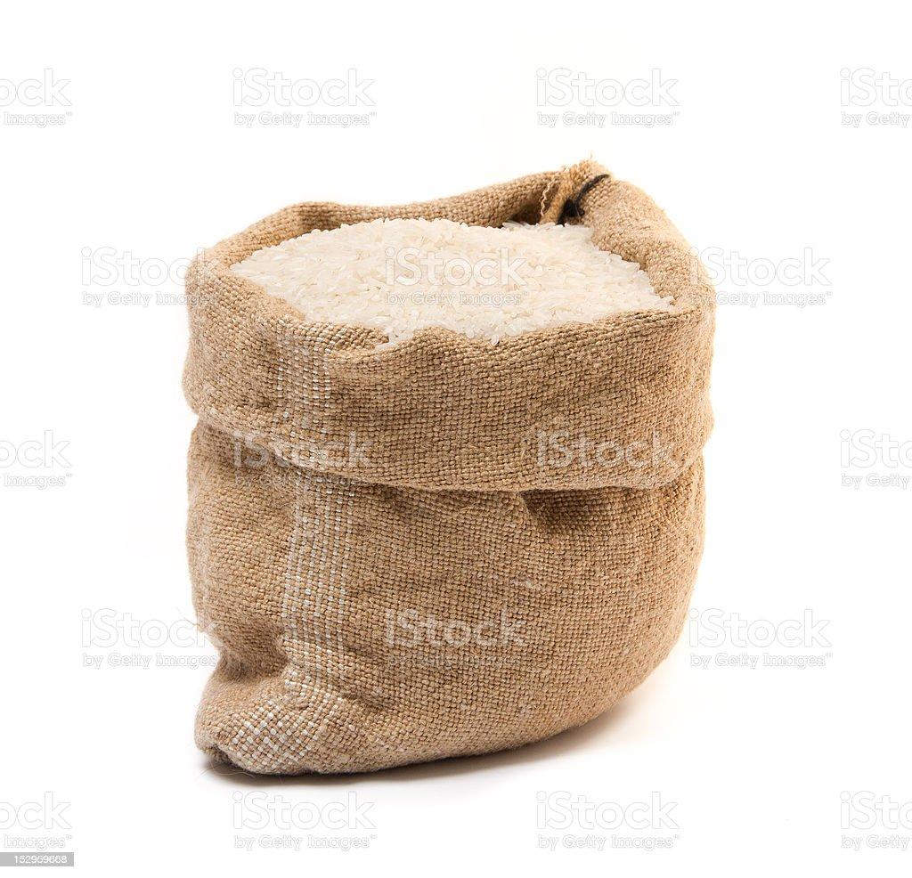 Burlap sack full of rice stock photo
