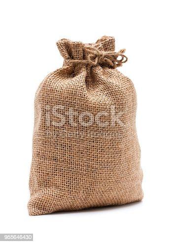 istock Burlap sack isolated on white background 955646430