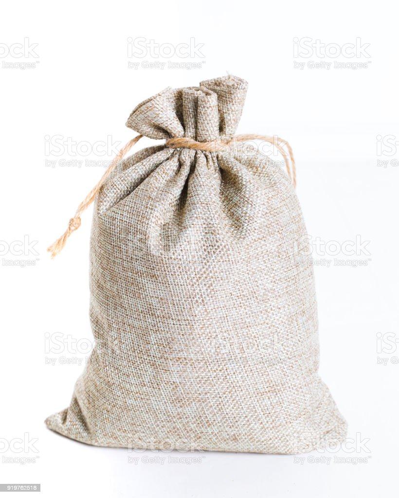 Burlap sack on white background stock photo