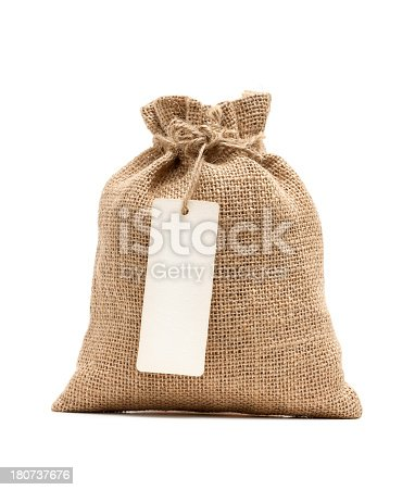 istock Burlap sack with blank label isolated on white background 180737676