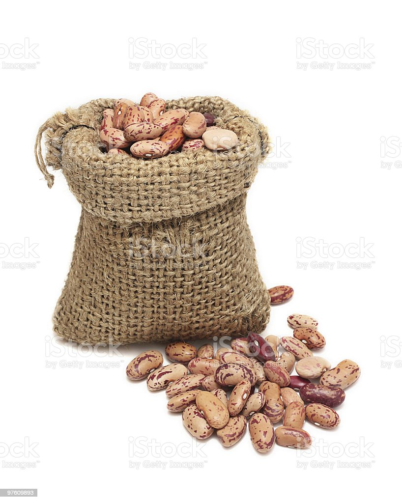 Burlap sack with red beans spilling out royalty-free stock photo