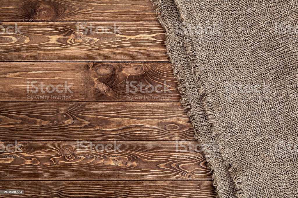 Burlap texture on wooden table background stock photo