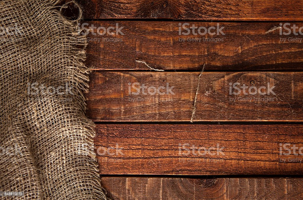 Burlap texture on wooden table stock photo
