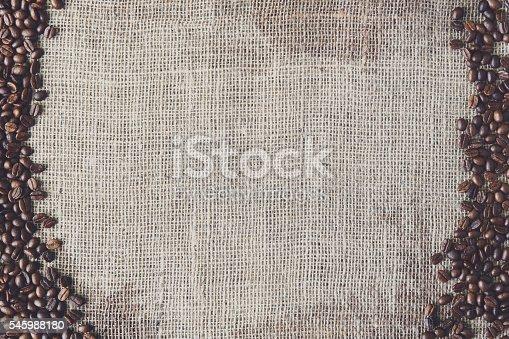 istock Burlap texture with coffee beans border 545988180