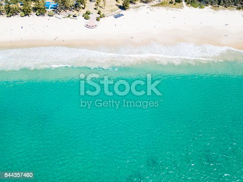 An aerial view of Burleigh Heads beach on Queensland's Gold Coast in Australia on a clear blue water day.