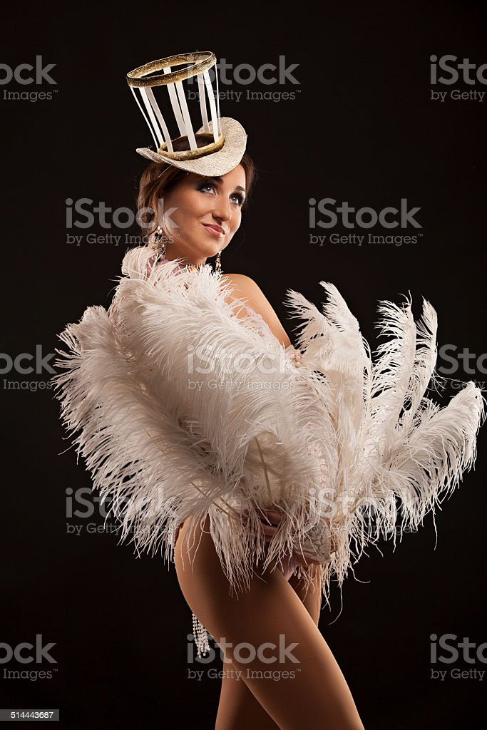 Burlesque dancer in white dress with plumage stock photo