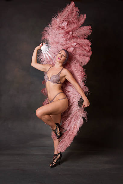 burlesque dancer with feather fans - burlesque stock photos and pictures