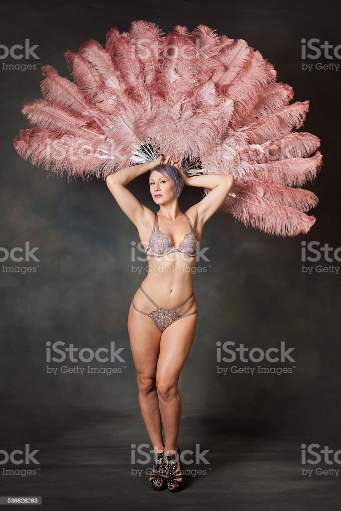 Burlesque dancer with feather fans stock photo