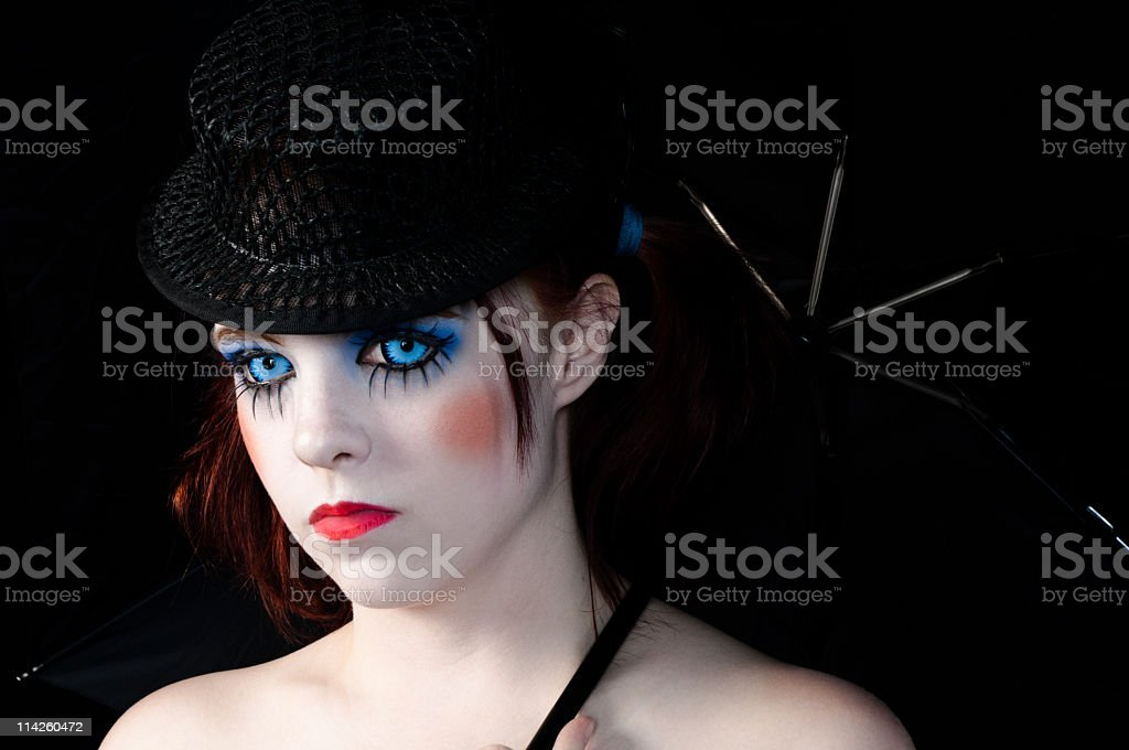 Burlesque girl with blue eyes stock photo