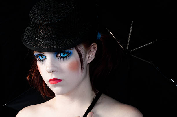 burlesque girl with blue eyes - kellyjhall stock pictures, royalty-free photos & images