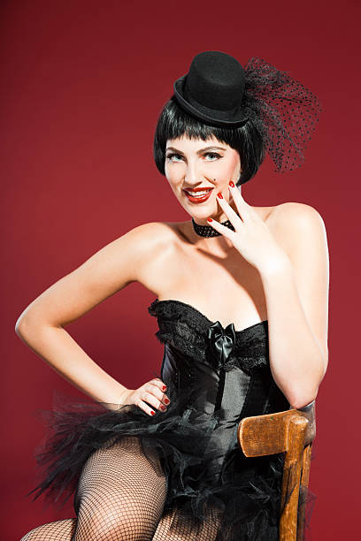 burlesque pin up woman with black hair dressed in black. - burlesque stock photos and pictures