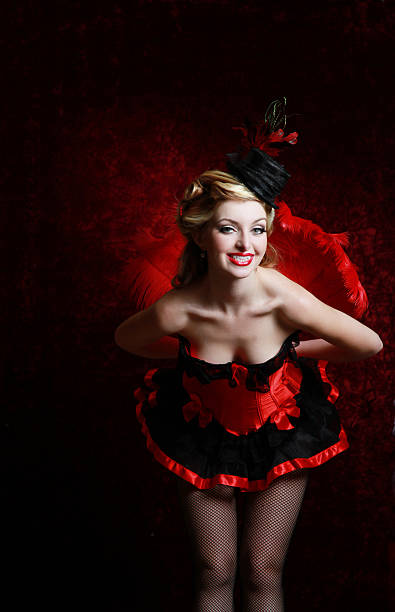 burlesque woman in red holding feather fan - burlesque stock photos and pictures