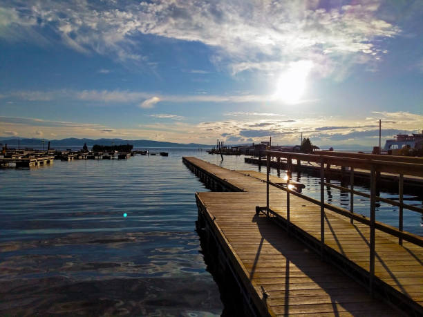 Burlington Dock Overlooking Sunset on Lake Placid stock photo