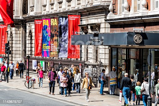 1125782554 istock photo Burlington House on Piccadilly Circus with MG Motors car dealership on street 1143675707