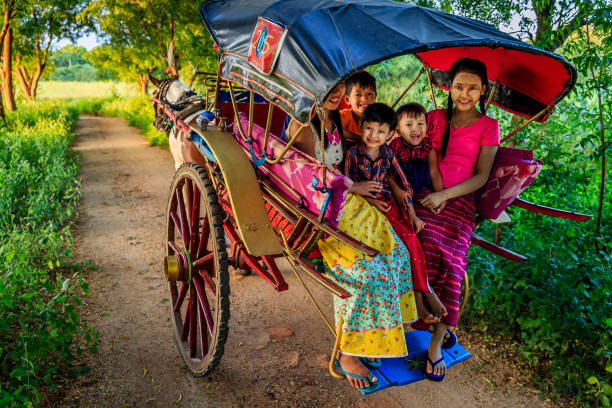 Burmese children sitting on a horse cart, Bagan, Myanmar Burmese children with thanaka sitting on a horse cart near the ancient temples of Bagan, Myanmar (Burma) indochina stock pictures, royalty-free photos & images
