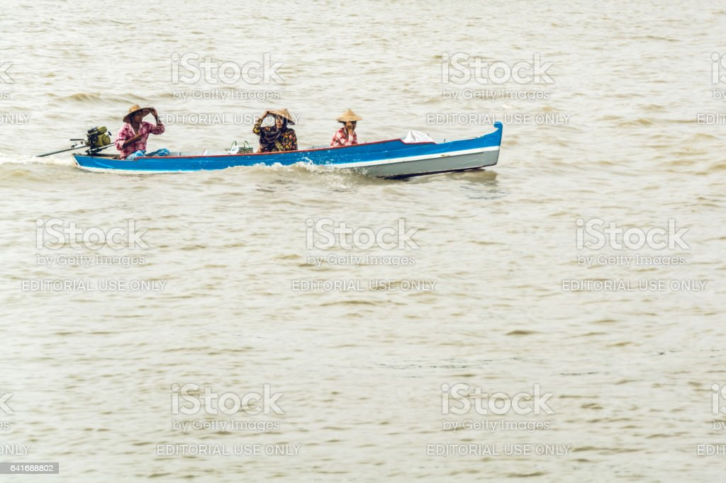 Burmese commuters travelling by homemade motor boat 2 stock photo