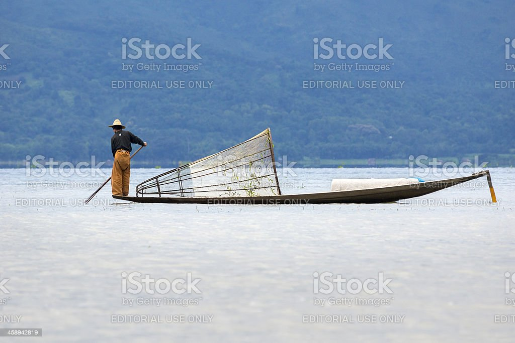 Burmese fisherman standing on a canoe, Inle Lake royalty-free stock photo