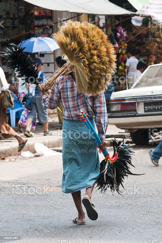 Burmese man with brooms royalty-free stock photo