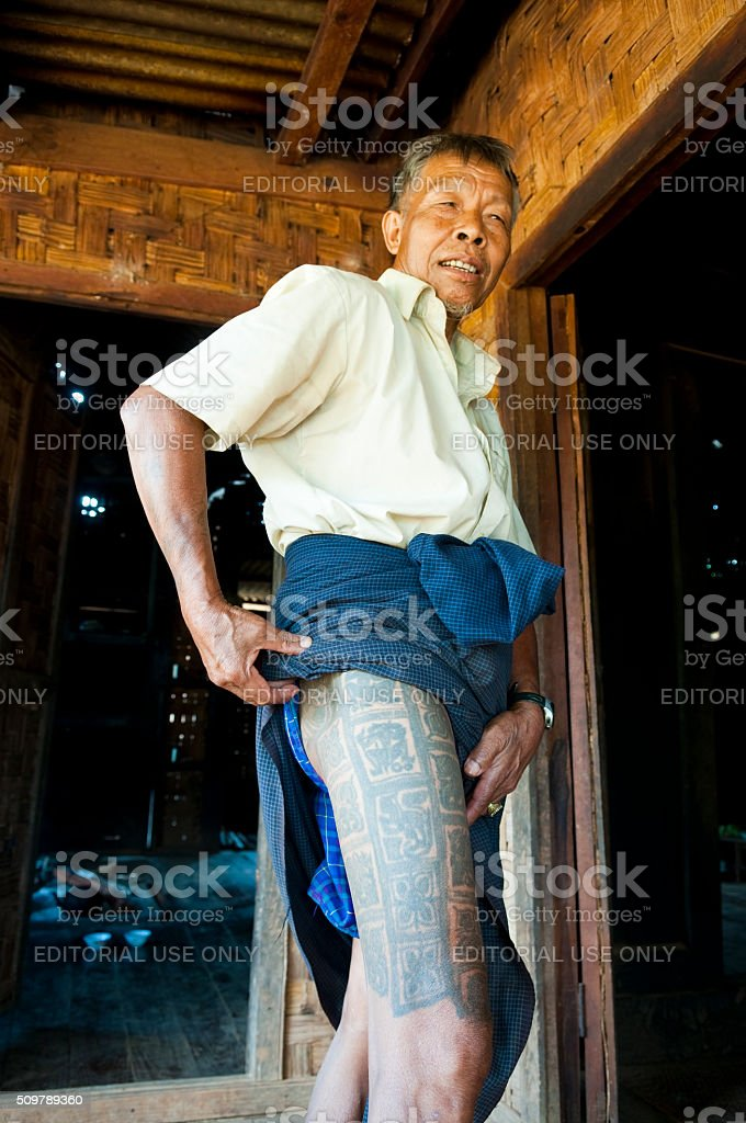 Burmese Man Showing Traditional Tattoos On Thigh Stock Photo