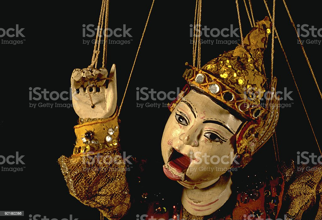 Burmese marionette against black background stock photo