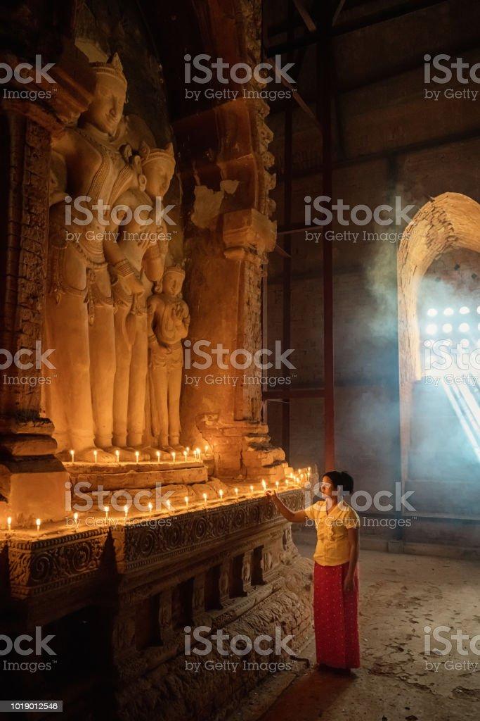 Burmese Woman Praying Buddha Temple Pagoda Bagan Myanmar royalty-free stock photo